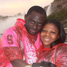 Kofi and Christa Opoku, from Columbus, Ohio, pose for a picture aboard Hornblower Niagara's first-ever sunset cruise, June 1, in Niagara Falls. The couple extended their visit to take in the maiden voyage of Hornblower's evening cruises. Photo: Corey Larocque
