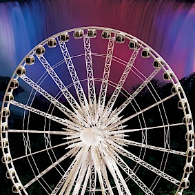 skywheel with illuminated falls in background